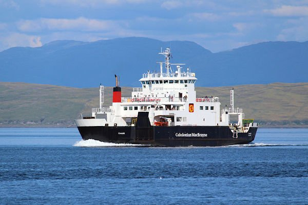 MULL, SCOTLAND, 25 JULY 2018: MV Coruisk sailing in the sound of Mull. It is a Caledonian Maritime Assets Ltd ferry built in 2003, operated by Caledonian MacBrayne, serving the west coast of Scotland.